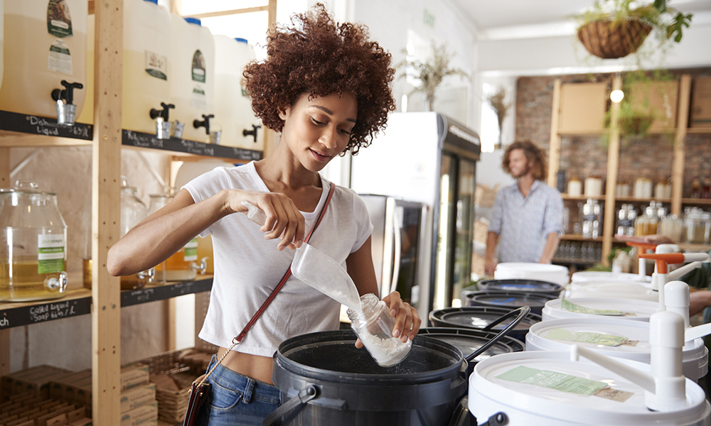 Woman filling container with washing powder